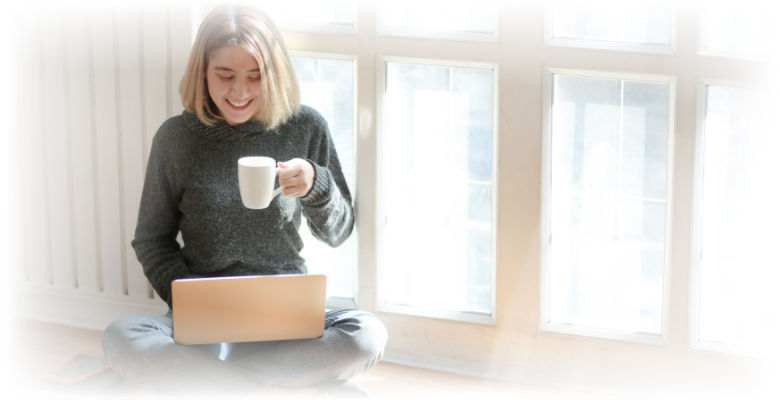 Woman on Laptop drinking tea