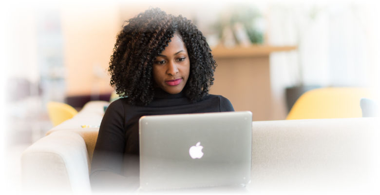 Woman with dark skin on laptop